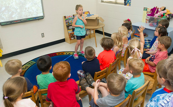 Six-year-old beekeeper Lila Cade answers children's questions after her presentation on beekeeping on Wednesday morning at the Child Development Center at Missouri Southern State College. <br /> Globe | Laurie Sisk