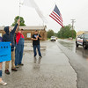 A handful of peaceful protestors voice their concerns on Thursday at outside the Lampo Community Center in Neosho.<br /> Globe | Laurie Sisk