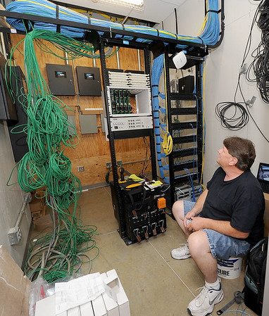 Carthage R-9 IT Specialist Steve Kelley checks out some of the 61-miles of network cable inside the new intermediate school on Thursday in Carthage.<br /> Globe | Laurie Sisk