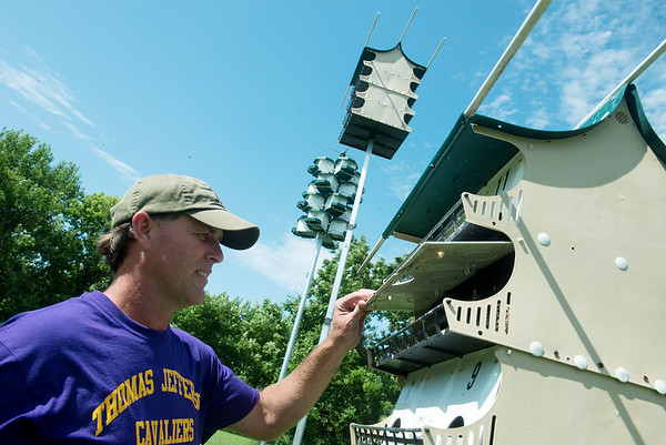 Globe/Roger Nomer<br /> Carter Henson checks on baby Purple Martins on Thursday afternoon at his home in Neosho.