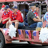 Carl Junction veterans receive applause as they make their way down the parade route during the Fourth of July Parade in downtown Carl Junction on Monday.<br /> Globe | Laurie Sisk