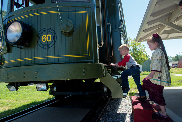 Globe/Roger Nomer<br /> Hunter, 4, and Emma, 6, Sampson, Neosho, board the Street Car #60 on Thursday.