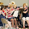 Members of the Heartland Concert Band put on a free patriotic concert for mall shoppers on Monday at Northpark Mall.<br /> Globe | Laurie Sisk