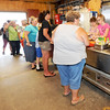 Diners stand in line for an afternoon meal on Wednesday at Feeding Inc. Since transitioning from the former River Street Pantry, Feeding Inc. has expanded its programs to include language classes and teaching workplace skills, while feeding about 2.000 people per month.<br /> Globe | Laurie Sisk