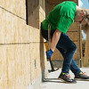 Globe/Roger Nomer<br /> Joycelle Shoemaker, 16, Grand Rapids, Mich., works on a house on Kentucky as she volunteers on Wednesday with World Renew Disaster Response Services.