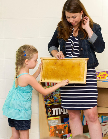 Six-year-old beekeeper Lila Cade explains what happens in a hive during her presentation on beekeeping on Wednesday morning at Missouri Southern State College. Assisting Cade is her mother, Lindsey Cade.<br /> Globe | Laurie Sisk