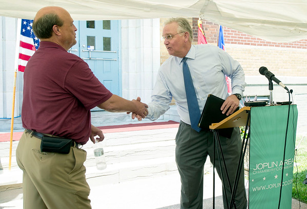 Rob O'Brian, of the Joplin Area Chamber of Commerce, shakes hands with Missouri Gov. Jay Nixon during a press conference announcing the opening of HS Baking at the location of the old Annie's Bakery on Maiden Lane on Tuesday afternoon. The opening will mean an additional 60 jobs initially, with a possible increase later.<br /> Globe | Laurie Sisk