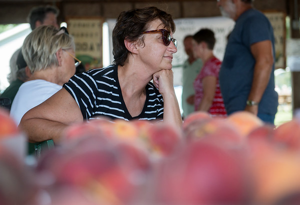 Globe/Roger Nomer<br /> Gail Fleener, Willard, waits in line for peaches from Pate's Orchard on Tuesday at the Webb City Farmers Market.