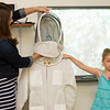 Six-year-old beekeeper Lila Cade explains the function of a bee suit during her presentation on beekeeping on Wednesday morning at Missouri Southern State College. Assisting Cade is her mother, Lindsey Cade.<br /> Globe | Laurie Sisk