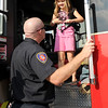 Joplin firefighter Tim Hathcock gives seven-year-old Brooke Vogl, of Jasper, a close up look at a firetruck during the Joplin Independence Day Celebration on Monday at the Joplin Athletic Complex.<br /> Globe | Laurie Sisk