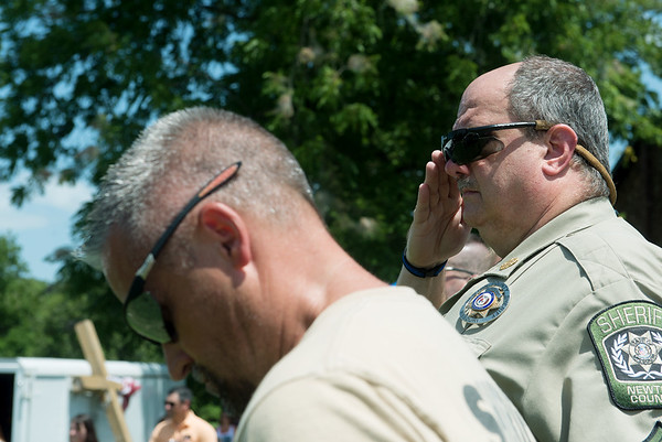 Globe/Roger Nomer<br /> Members of the Newton County Sheriff Department listen to Taps as they recognize recent fallen officers around the country on Sunday at a rally to support law enforcement officers at the Lampo Building in Neosho.