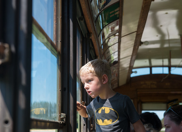 Globe/Roger Nomer<br /> Abram Norvell, 3, Sioux Falls, S.D., watches scenery from the Webb City Street Car #60 on Thursday afternoon in King Jack Park.