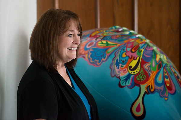 "Globe/Roger Nomer<br /> On Friday, Rebecca Brubaker, executive director, talks about the football artwork ""New Beginnings"" which is being donated to Safehouse in Pittsburg."