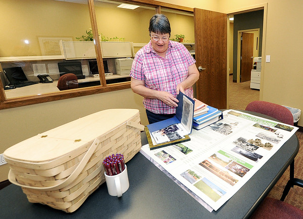 Beverly Ash, Carthage,  thumbs through some of the articles and information she collected while researching Wildcat Park and the Wildcat Glades Conservation and Audubon Center. Posters using the information she gathered wil be hung during the Shoal Creek Water Festival in mid-August.<br /> Globe | Laurie Sisk