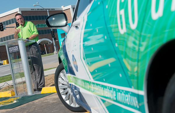 Globe/Roger Nomer<br /> Brad Beecher, president and CEO at Empire Electric, talks on Wednesday about the electric car charging station at Missouri Southern.