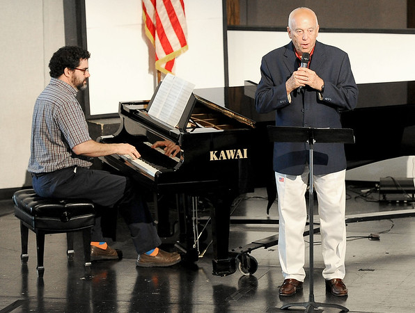 """Soloist Murray Hollis, right, accompanied by pianist Gary Jordan, entertains a crowd of about 200 people with their rendition of """"Statue of Liberty"""" during the Joplin Area Organists' Association's """"Patriotic Flushes"""" on Saturday at the Ozark Christian College Chapel.<br /> Globe 