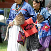 Sisters Buryl Stands of Binger, Okla., and Lita Wilson of Anadarko, Okla. perform the Turkey Dance at the Quapaw Pow Wow on Saturday in Quapaw, Okla.<br /> Globe | Laurie Sisk