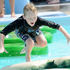 Eight-year-old Lucas Gillette has fun trying to navigate the lily pad feature at Cunningham Pool on Friday.<br /> Globe | Laurie Sisk