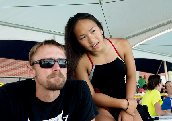 Globe/Roger Nomer<br /> Haven Shepherd talks strategy with her coach Shawn Klosterman as they watch the races on Friday, July 15, at Schifferdecker Pool.