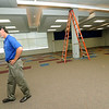 Carthage R-9 Assistant Superintendent for Business Mark Baker walks through the expansive media center at the district's new intermediate school on Thursday.<br /> Globe | Laurie Sisk