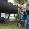 Globe/Roger Nomer<br /> Dan Yates, Mulberry, Kan., sets up Grammy's BBQ stand on Friday in Seneca.