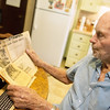 Globe/Roger Nomer<br /> Jim Babcock looks at an article about the Hercules Plant explosion on Friday at his home in Carthage.