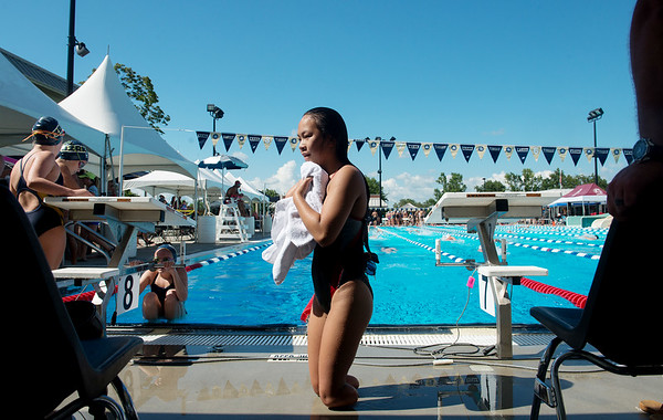 Globe/Roger Nomer<br /> Haven Shepherd exits the Schifferdecker Pool after warmups for a swim meet on Friday, July 15.