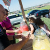 Globe/Roger Nomer<br /> Duquesne Police Chief Tommy Kitch buys a cup of lemonade from Finley Williams, 6, on Thursday afternoon.