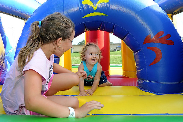 Cousins Annalise Prater, 9 and Kaydence Prater, 19 months, have a little fun in one of the inflatable games in the Kids' Zone during the Joplin Independence Day Celebration on Monday at the Joplin Athletic Complex.<br /> Globe | Laurie Sisk