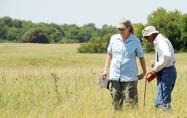 Joplin botanist Cyndi Cogbill, left and former Missouri Southern biology professor Kip Heth, check out some of the native plants during a dedication of Carver Prairie, southeast of Joplin on Saturday.<br /> Globe | Laurie Sisk