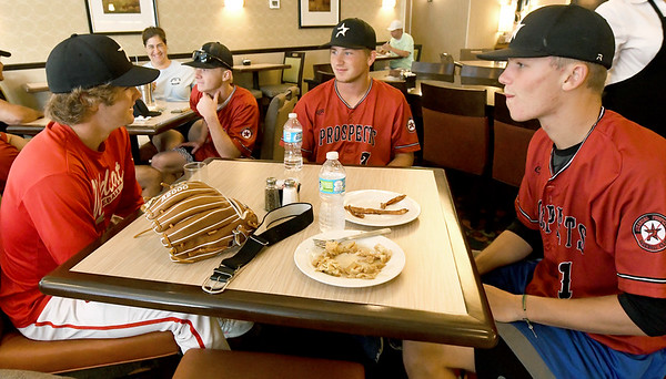 From the left: Arkansas Prospects players Pate Fullerton, Preston Fleeman, Chance Johnson and Kade Stuart enjoy breakfast at Homewood Suites by Hilton before departing for their first game of the Premier Baseball Tournament on Wednesday morning.<br /> Globe | Laurie Sisk