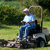 Cheryl Jenkinson, of Moline, Kan., takes a test drive during the Farm Talk Mower Demo during the first day of the Four States Farm Show on Friday in Pittsburg. The show continues through Sunday.<br /> Globe | Laurie Sisk