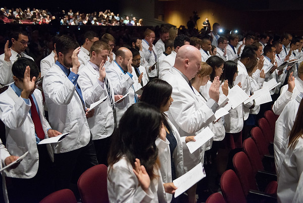Globe/Roger Nomer<br /> Student doctors recite the Osteopathic Oath during Monday's Kansas City University of Medicine and Biosciences White Coating Ceremony at Joplin High School.