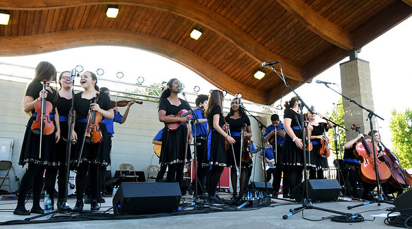 "The ladies of the Saline Fiddlers Philharmonic take center stage for a vocal performance of ""Rocky Top"" during the ""Fiddlers on the Route"" music Festival on Saturday night at Landreth Park. The Connect2Culture event featured the Saline, Mi.-based group along with food and games for the children.<br /> Globe 