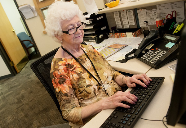 Globe/Roger Nomer<br /> Bonnie Mills, Carl Junction, works at the front desk of human resources in Joplin City Hall on Tuesday afternoon.