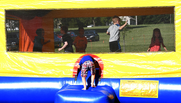 "Kids enjoy one of the inflatable games during the ""Fiddlers on the Route"" music festival on Saturday night at Landreth Park. The Connect2Culture event featured the Saline, Mi.-based Saline Fiddlers Philharmonic along with food and games for the children.<br /> Globe 