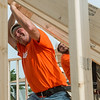 Globe/Roger Nomer<br /> Eric Blake, operations manager at Home Depot in Joplin, helps raise a wall on Wednesday while working with Habitat for Humanity in Joplin.