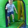 "Two-year-old Ben Korman bounces through an inflatable maze during the ""Fiddlers on the Route"" music festival on Saturday night at Landreth Park. The Connect2Culture event featured the Saline, Mi.-based Saline Fiddlers Philharmonic along with food and games for the children.<br /> Globe 