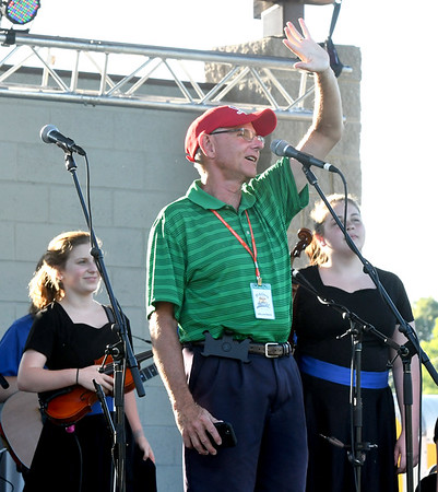"Clifford Wert, president of Connect2Culture, welcomes guests to the ""Fiddlers on the Route"" music festival on Saturday night at Landreth Park.<br /> Globe 