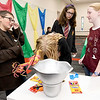 "From the left: J.D. Smith, 11, Mairi Beranek, 12, Megan Meeker, 11 and Hannah Davis, 11 illustrate their favorite Harry Potter moments and place them into a pensieve to later be posted on the library's facebook page. The station, named ""Dumbledorf's Pensieve"" was one of several on Saturday at the Joplin Public Library as part of the 20th Anniversary of the popular series of books and movies.<br /> Globe 