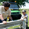 "From the left: George Washington Carver National Monument Intern Victoria Pollard attaches signage to a saw horse as Carver maintenance worker Chris Reed looks on during preparations for Carver Day, which begins at 10 a.m. with music, theatre and Peter Burchard , author of ""Carver: A Great Soul."" Activities conclude at 3 p.m.<br /> Globe 