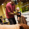 Globe/Roger Nomer<br /> Michael Gammon helps Lincoln, 9 months, onto a horse on Saturday at the Freeman NICU reunion at the Joplin Convention and Trade Center. Lincoln is a graduate of the Freeman NICU.