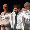 Globe/Roger Nomer<br /> Zack Wages, Joplin, receives his white coat from Ross Sciara during Monday's Kansas City University of Medicine and Biosciences White Coating Ceremony at Joplin High School.