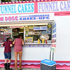 From the left: Lauren Page, 12, of Joplin and Lexus Eudy, 14, of Dallas, Texas, check out the offerings at one of numerous concessions on the first day of the Newton County Fair on Wednesday in Neosho.<br /> Globe | Laurie Sisk