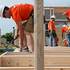 Globe/Roger Nomer<br /> Jeff Spangler, operations manager for Home Depot in Pittsburg, works on a house on Wednesday with Habitat for Humanity in Joplin.