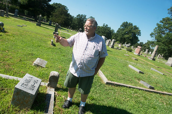 Globe/Roger Nomer<br /> Tom Divine talks about gravesites at the Carterville Cemetery on July 10.