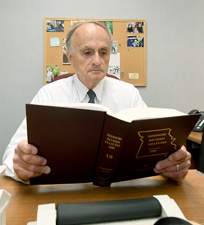 Longtime Jasper County Public Defender Larry Maples reads a book on Missouri laws in his Carthage office on Thursday. Maples retires Monday after 35 years of service to Jasper County residents.<br /> Globe | Laurie Sisk