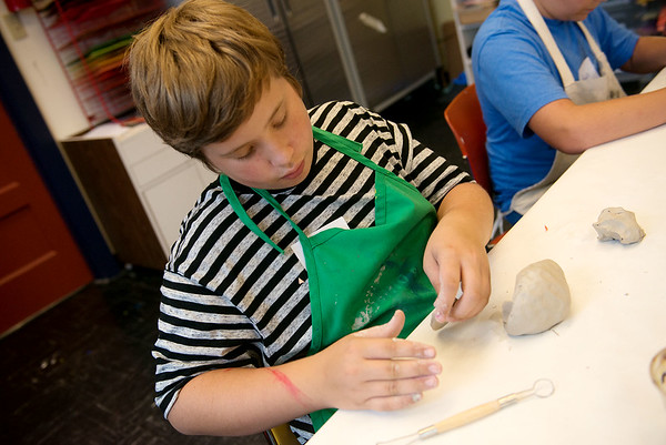 Globe/Roger Nomer<br /> Harrison Spear, 12, Tulsa, Okla., works on a pinch pot monster on Monday during Clay Camp at the Spiva Center for the Arts.