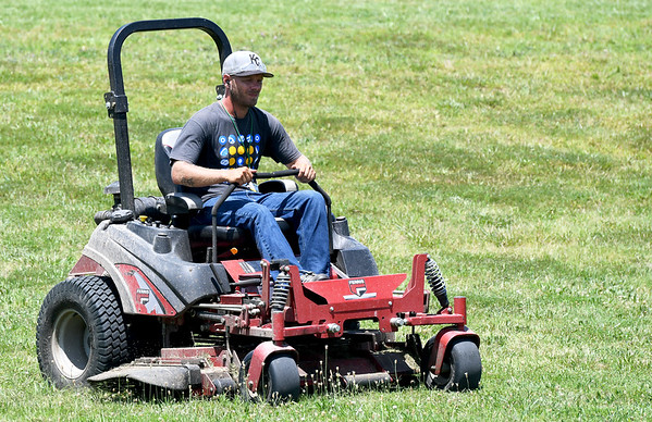 Missouri Southern groundskeeper Cody Eubanks braves heat indicies Tuesday well above triple digits as he mows the cross country venue at MSSU.<br /> Globe | Laurie Sisk