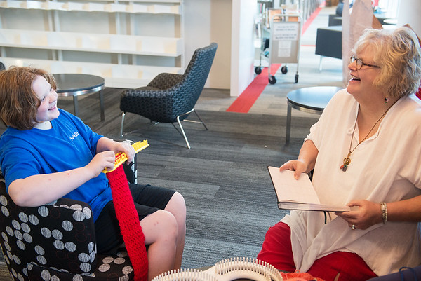Globe/Roger Nomer<br /> Jackie Wiese, 12, chats with Ann Leach as they knit on Monday at the Joplin Public Library.